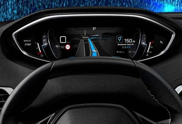 Il cruscotto di un'auto Peugeot con la navigazione stradale di TomTom