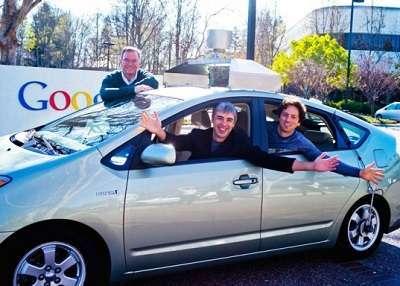 schmidt, page e brin con una google car